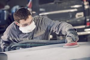 bigstock-auto-repairman-grinding-autobo-123767120